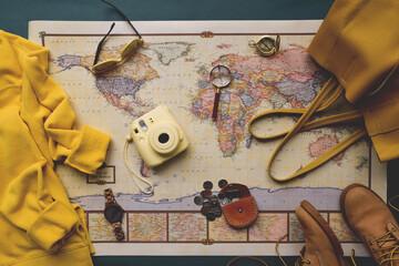 Fototapeta Map of the world and travel essentials flatlay obraz