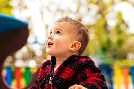 beautiful baby boy portrait in a playground
