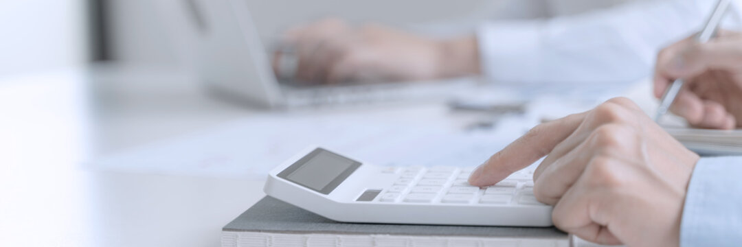 Accountant or banker making calculations Bookkeeper Clerk, Bank Advisor And Auditor.