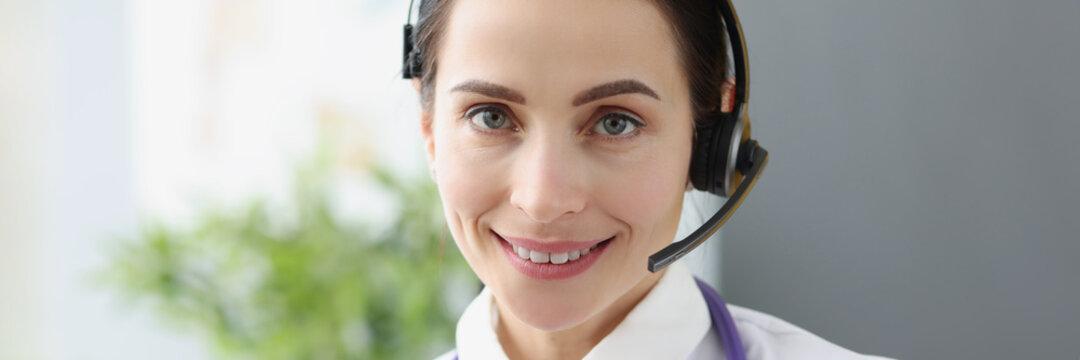 Portrait of doctor operator in headphones for remote work
