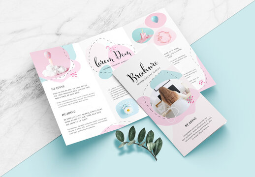 Minimal Brochure Layout with Green and Pink Accents