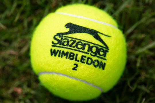 LONDON, UK - June 2021: Official wimbledon tennis Slazenger brand ball on grass