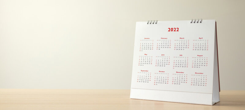 Close up 2022 calendar page dates and month background business planning appointment meeting concept
