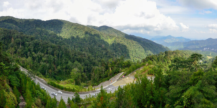 Curve road up to the Genting Highlands Malaysia with green tree and sky at Bentong Pahang.