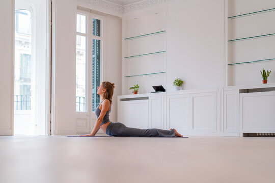 Flexible woman doing yoga in Cobra pose