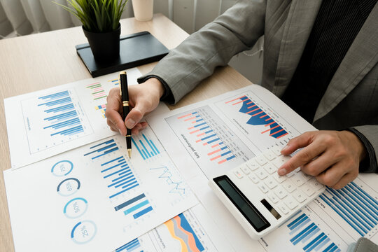 Businessman working in finance and accounting Analyze financial budget in the office.