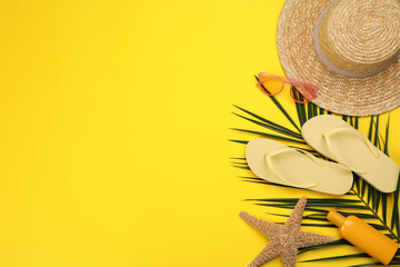 Obraz Flat lay composition with beach objects on yellow background, space for text - fototapety do salonu