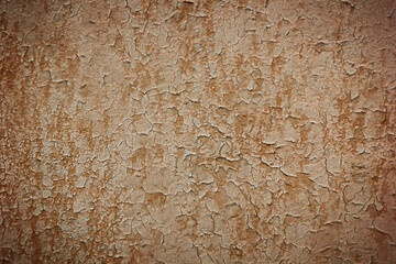 Old painted wall damage surface. Background of old red wall