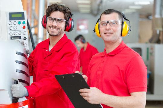 portrait of happy men in factory
