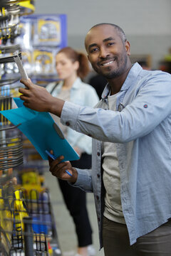 male customer in hardware store selecting products