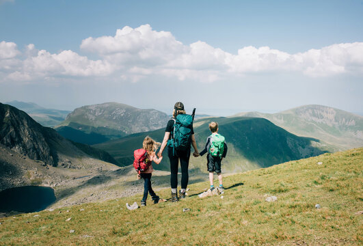 mom taking a moment with her kids to enjoy the view of Mount Snowdon