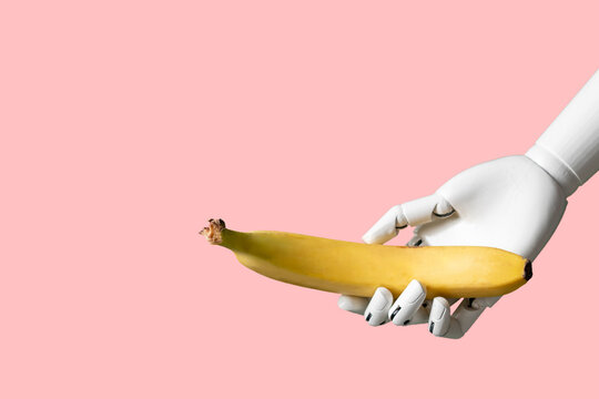creative concept of robot hand holding yellow fruit banana isolated