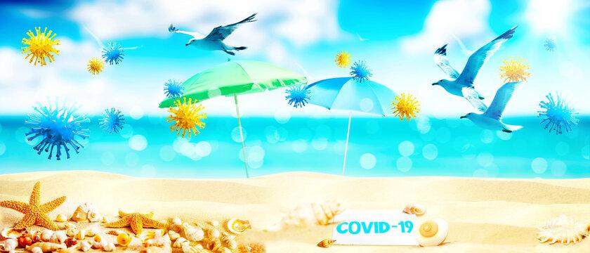 Blue beach umbrella with coronavirus on vacation