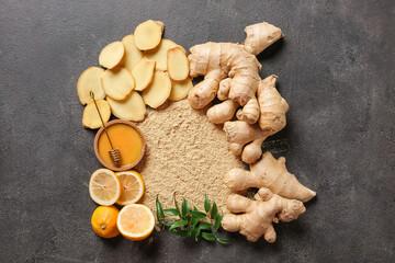 Fresh and ground ginger on dark background