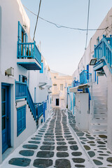 Mykonos Greece, colorful streets of the old town of Mykonos, Traditional narrow street with blue doors and white walls, Mykonos town Greece