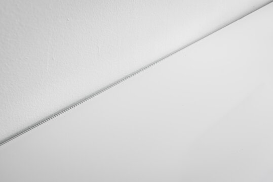 White background with a diagonal line