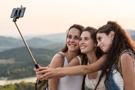 Traveling women taking selfie in mountains