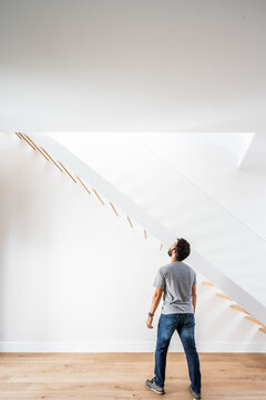 Unrecognizable man near staircase in contemporary house