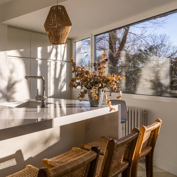 Interior of dining zone in cozy light kitchen
