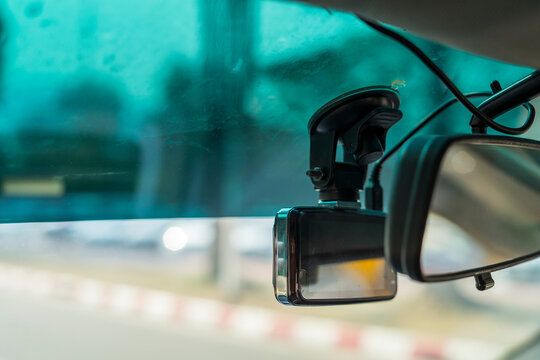 video recorder next to a rear view mirror, CCTV car camera for safety on the road accident