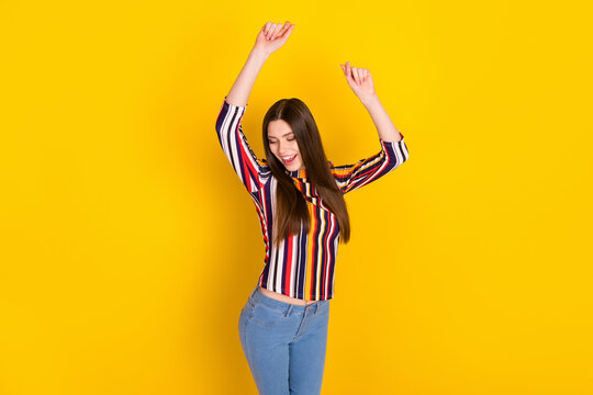 Top above high angle view photo of young woman happy positive smile have fun dance isolated over yellow color background