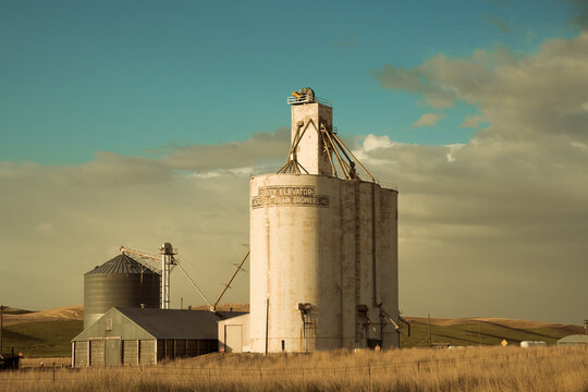 View of industrial grain elevator seen from wheat farm in the Palouse Washington state