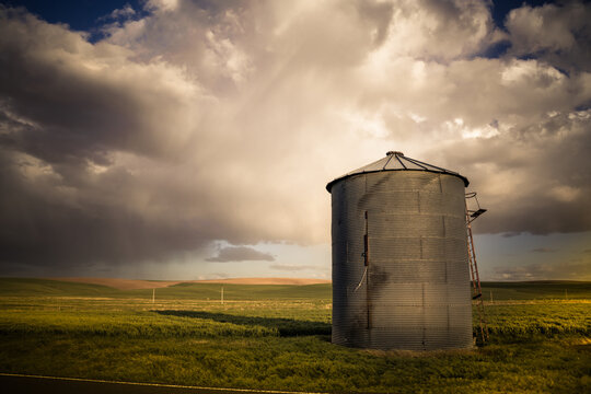 View of industrial grain silo from wheat farm in the Palouse Washington State