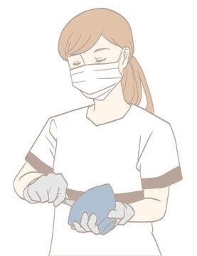 印象を練る歯科衛生士(パステルカラー)