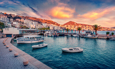 Fototapeta Fantastic spring cityscape of Saranda port. Captivating Ioninian seascape. Wonderful evening scene of Albania, Europe. Traveling concept background. obraz