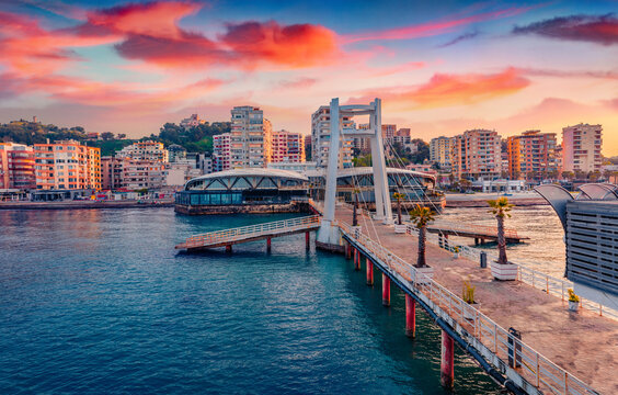 Spectacular sunrise in Durres, port city on the Adriatic Sea in western Albania, Europe. Impressive Adriatic seascape. Exotic spring scene of Albania. Traveling concept background.