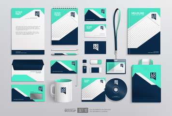 Obraz Stationery office items Mockup set with corporate brand identity design. Blue and white abstract graphics. Business stationery mockup. Office equipment set of paper bag, white mug, notepad, envelope - fototapety do salonu