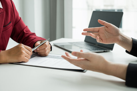 Business people hold a resume and talk to job applicants for job interviews about careers and Their personal history in the company. Recruitment concepts