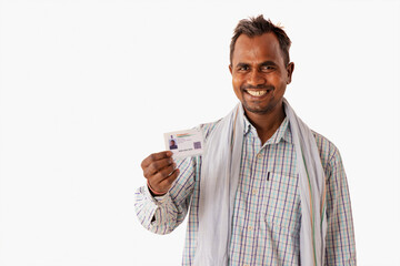 Fototapeta A MANUAL LABOURER HAPPILY SHOWING AADHAR CARD IN FRONT OF CAMERA obraz