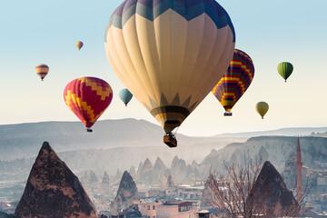 Cappadocia landscape with Hot Air Balloons on sunrise in Goreme village, Turkey.