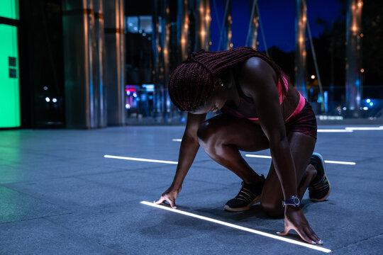Sportswoman prepared to run start