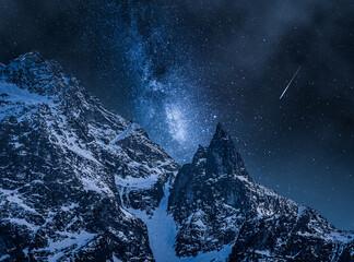 Milky way over mountain lake. Night sky in winter.