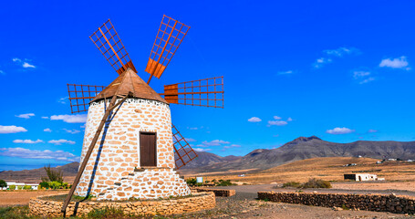 Traditional old windmills and scenic landscape of volcanic Fuerteventura , Canary islands of Spain