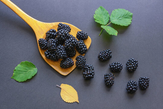 Fresh ripe blackberries on dark background. Flat lay. Free space for text