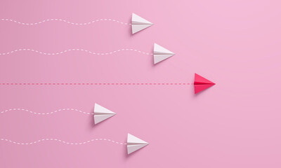Obraz Women's leadership concepts with red paper airplane leading among white on pink background. - fototapety do salonu