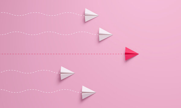 Women's leadership concepts with red paper airplane leading among white on pink background.
