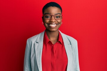 Fototapeta Young african american woman wearing business jacket and glasses with a happy and cool smile on face. lucky person. obraz