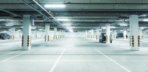 Fototapeta Horizontal image of clean white underground parking lot obraz