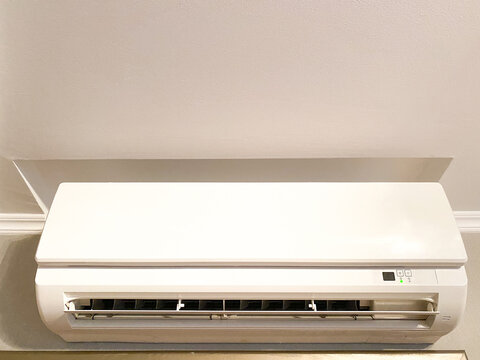 White wall-mounted air conditioner in a house or apartment close-up