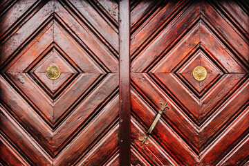 Obraz Rustic wooden door detail as background, weathered surface of massive entrance doorway - fototapety do salonu