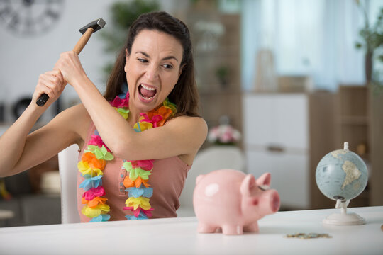breaking a piggy bank in anger