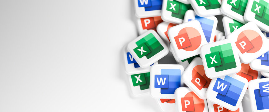 Logos of the Microsoft Office components Word, Excel, Powerpoint on a heap. Copy space. Web banner format.