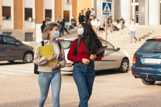 two student girls leaving class