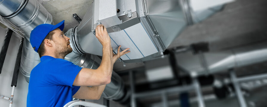 ventilation system installation and repair service. hvac technician at work. banner copy space