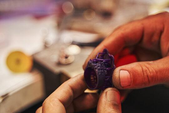 Plastic ring prototype in hands of jeweler