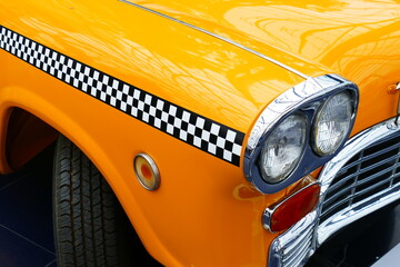 Details of the front of an old yellow cab of New York.